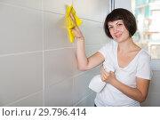 Купить «Woman washing tiles with rag», фото № 29796414, снято 22 ноября 2018 г. (c) Яков Филимонов / Фотобанк Лори