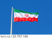 Купить «Flag of Iran waving in the wind against the sky», фото № 29797186, снято 17 июня 2018 г. (c) FotograFF / Фотобанк Лори