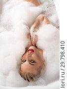 Купить «Erotic young blonde in foam bath», фото № 29798410, снято 21 февраля 2019 г. (c) Гурьянов Андрей / Фотобанк Лори