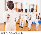Купить «Young female in mask with foil at fencing workout», фото № 29798842, снято 11 июля 2018 г. (c) Яков Филимонов / Фотобанк Лори