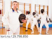 Купить «Man fencer in uniform with mask and foil», фото № 29798850, снято 11 июля 2018 г. (c) Яков Филимонов / Фотобанк Лори