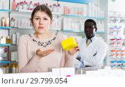 Купить «surprised by prices girl holding medicine», фото № 29799054, снято 2 марта 2018 г. (c) Яков Филимонов / Фотобанк Лори