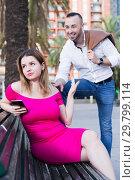 Купить «Young woman is inaccessibility when man is playful talking with her», фото № 29799114, снято 18 октября 2017 г. (c) Яков Филимонов / Фотобанк Лори