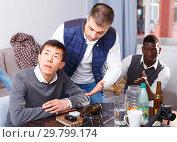Купить «Chagrined man with friends», фото № 29799174, снято 23 февраля 2018 г. (c) Яков Филимонов / Фотобанк Лори
