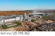 Wood processing at a woodworking plant.Aerial view. Стоковое видео, видеограф Никита Ковалёв / Фотобанк Лори