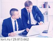 Купить «cheerful two males coworkers working in firm office», фото № 29813662, снято 20 марта 2019 г. (c) Яков Филимонов / Фотобанк Лори