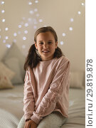 Купить «Innocent girl sitting in bedroom at home», фото № 29819878, снято 6 ноября 2018 г. (c) Wavebreak Media / Фотобанк Лори