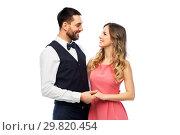 Купить «happy couple in party clothes», фото № 29820454, снято 30 ноября 2018 г. (c) Syda Productions / Фотобанк Лори
