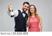 Купить «happy couple with bottle of champagne and glasses», фото № 29820458, снято 30 ноября 2018 г. (c) Syda Productions / Фотобанк Лори