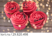 Купить «close up of cupcakes with red buttercream frosting», фото № 29820498, снято 8 февраля 2018 г. (c) Syda Productions / Фотобанк Лори