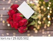 Купить «close up of red roses and note», фото № 29820502, снято 8 февраля 2018 г. (c) Syda Productions / Фотобанк Лори