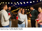 Купить «friends with drinks dancing at rooftop party», фото № 29820526, снято 2 сентября 2018 г. (c) Syda Productions / Фотобанк Лори