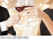 Купить «close up of couple clinking champagne glasses», фото № 29820602, снято 3 апреля 2013 г. (c) Syda Productions / Фотобанк Лори