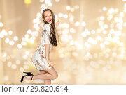 Купить «happy young woman or teen girl in fancy dress», фото № 29820614, снято 31 октября 2015 г. (c) Syda Productions / Фотобанк Лори