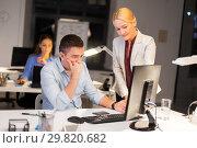 Купить «business team with computer working late at office», фото № 29820682, снято 6 декабря 2017 г. (c) Syda Productions / Фотобанк Лори