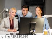 Купить «business team with computer working late at office», фото № 29820690, снято 6 декабря 2017 г. (c) Syda Productions / Фотобанк Лори