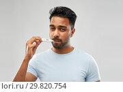 Купить «man measuring oral temperature by thermometer», фото № 29820754, снято 27 октября 2018 г. (c) Syda Productions / Фотобанк Лори