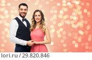 Купить «happy couple in party clothes», фото № 29820846, снято 30 ноября 2018 г. (c) Syda Productions / Фотобанк Лори
