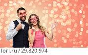 Купить «couple with party props having fun and posing», фото № 29820974, снято 30 ноября 2018 г. (c) Syda Productions / Фотобанк Лори