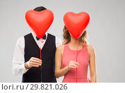 Купить «couple hiding behind red heart shaped balloons», фото № 29821026, снято 30 ноября 2018 г. (c) Syda Productions / Фотобанк Лори