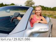 happy young woman driving convertible car. Стоковое фото, фотограф Syda Productions / Фотобанк Лори