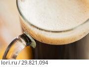 Купить «close up of dark draft beer glass mug», фото № 29821094, снято 31 января 2018 г. (c) Syda Productions / Фотобанк Лори