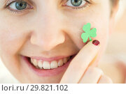 Купить «close up of happy young woman face with shamrock», фото № 29821102, снято 31 января 2018 г. (c) Syda Productions / Фотобанк Лори