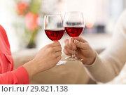 Купить «hands of couple clinking red wine glasses», фото № 29821138, снято 15 февраля 2018 г. (c) Syda Productions / Фотобанк Лори