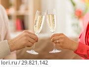 Купить «close up of couple clinking champagne glasses», фото № 29821142, снято 15 февраля 2018 г. (c) Syda Productions / Фотобанк Лори