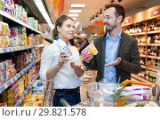 Купить «Couple is looking on shelves with variety products in the supermarket.», фото № 29821578, снято 4 апреля 2018 г. (c) Яков Филимонов / Фотобанк Лори