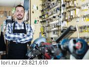Купить «Worker demonstrating result of his key shaping», фото № 29821610, снято 2 февраля 2017 г. (c) Яков Филимонов / Фотобанк Лори