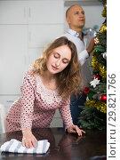 Купить «Wife and husband getting ready for Christmas», фото № 29821766, снято 10 января 2019 г. (c) Яков Филимонов / Фотобанк Лори