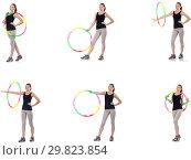 Купить «Young woman with hula hoop isolated on white», фото № 29823854, снято 26 марта 2019 г. (c) Elnur / Фотобанк Лори