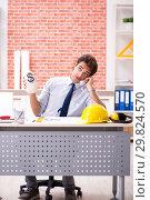 Купить «Construction supervisor working on blueprints», фото № 29824570, снято 13 сентября 2018 г. (c) Elnur / Фотобанк Лори