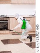 Купить «Professional contractor doing pest control at kitchen», фото № 29824646, снято 29 октября 2018 г. (c) Elnur / Фотобанк Лори