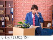 Купить «Young person being fired from his work», фото № 29825154, снято 10 сентября 2018 г. (c) Elnur / Фотобанк Лори