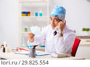 Young male doctor otolaryngologist working at the hospital. Стоковое фото, фотограф Elnur / Фотобанк Лори
