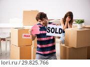 Купить «Young family selling their house», фото № 29825766, снято 21 сентября 2018 г. (c) Elnur / Фотобанк Лори