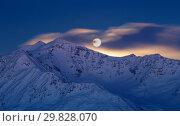 Moony sunrise from mount Cevedale in italian Alps of Valfurva, Valfurva, Valtellina, Lombardy, Italy, Europe. Стоковое фото, фотограф ClickAlps / age Fotostock / Фотобанк Лори