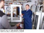 Professional labour demonstrating PVC profiles. Стоковое фото, фотограф Яков Филимонов / Фотобанк Лори