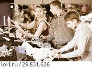 Купить «Mother,father and son choosing wear at the clearance sale shop», фото № 29831626, снято 13 апреля 2017 г. (c) Яков Филимонов / Фотобанк Лори