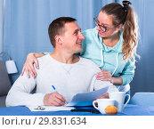 Купить «Couple signing papers», фото № 29831634, снято 18 марта 2017 г. (c) Яков Филимонов / Фотобанк Лори