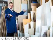Купить «portrait of man in uniform choosing tight wooden bar in picture», фото № 29831682, снято 19 марта 2019 г. (c) Яков Филимонов / Фотобанк Лори