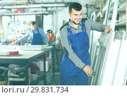 Купить «Workman is inspecting the window frame», фото № 29831734, снято 30 марта 2017 г. (c) Яков Филимонов / Фотобанк Лори