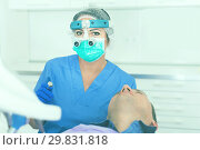 Купить «woman in uniform health tooth», фото № 29831818, снято 10 октября 2017 г. (c) Яков Филимонов / Фотобанк Лори