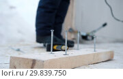 Купить «Construction site. Skrews sticking out of the board», видеоролик № 29839750, снято 20 марта 2019 г. (c) Константин Шишкин / Фотобанк Лори