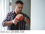 Купить «Male carpenter using drill machine», фото № 29840154, снято 3 августа 2017 г. (c) Wavebreak Media / Фотобанк Лори