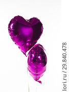 Купить «Valentine balloons against white background», фото № 29840478, снято 11 октября 2018 г. (c) Wavebreak Media / Фотобанк Лори