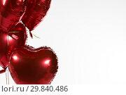 Купить «Valentine balloons against white background», фото № 29840486, снято 11 октября 2018 г. (c) Wavebreak Media / Фотобанк Лори