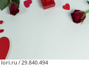 Купить «Valentine gifts and decorations on white background», фото № 29840494, снято 11 октября 2018 г. (c) Wavebreak Media / Фотобанк Лори